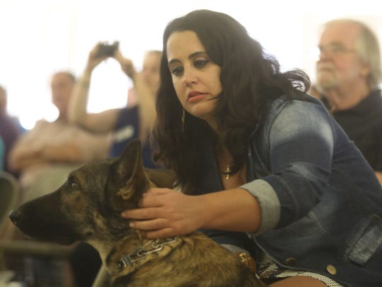 Maria Villela of Rio de Janeiro, Brazil, pets her guide dog during a graduation ceremony held at the Guide Dogs of the Desert in Whitewater. McDonald was one of five people who received guide dogs from the center.