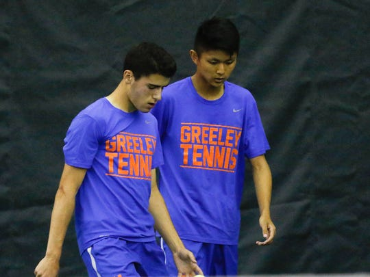 Horace Greeley's Dylan Glickman, left, and James Wei talk between serves in the doubles match of the Section 1 boys tennis finals at Sound Shore Indoor Tennis Center in Port Chester on Thursday, May 25, 2017.  Glickman and Wei took the doubles title.
