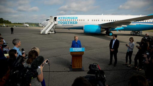 Democratic presidential candidate Hillary Clinton speaks to members of the media before boarding her campaign plane at Westchester County Airport  Thursday to travel to Charlotte, N.C., to attend a campaign rally.