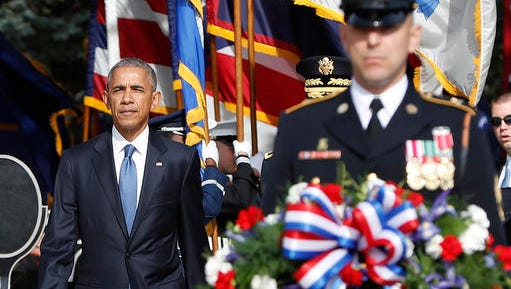 President Barack Obama arrives to lay the wreath at the Tomb of the Unknowns, on Veterans Day, Friday, Nov. 11, 2016, at Arlington National Cemetery in Arlington, Va.
