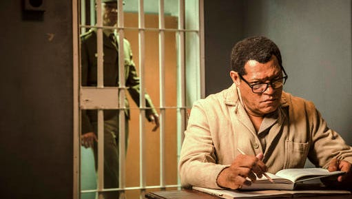 """This image released by BET shows Laurence Fishburne as Nelson Mandela in a scene from, """"Madiba,"""" a six-hour miniseries premiering on Wednesday, Feb. 1."""