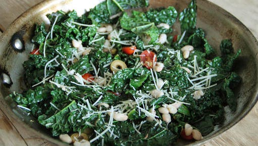 This Jan. 19, 2017 photo shows Tuscan kale sautéed with anchovies, olives, tomatoes and white beans in Coronado, Calif. This dish is from a recipe by Melissa d'Arabian.