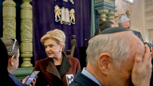 Congresswoman Carolyn Maloney, center, member of Congress's bipartisan task force combating anti-Semitism, speaks with a reporter after holding a press conference to address bomb treats against Jewish organizations and vandalism at Jewish cemeteries, Friday March 3, 2017, at the Park East Synagogue in New York.
