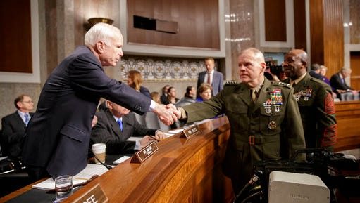"""Senate Armed Services Committee Chairman Sen. John McCain, R-Ariz., left, welcomes Marine Corps Commandant Gen. Robert B. Neller, center, and Sgt. Major of the Marine Corps Ronald L. Green on Capitol Hill in Washington, Tuesday, March, 14, 2017, prior to the start of the committee's hearing on the investigation of nude photographs of female Marines and other women that were shared on the Facebook page """"Marines United."""""""