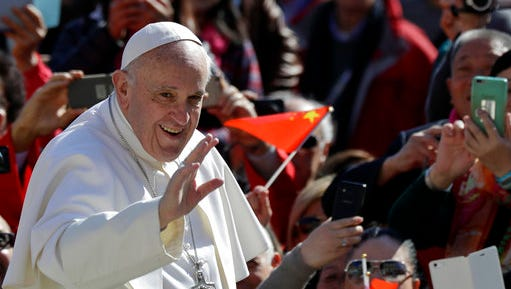 Pope Francis waves as he arrives for his weekly general audience in St. Peter square at the Vatican, Wednesday, March 15, 2017.