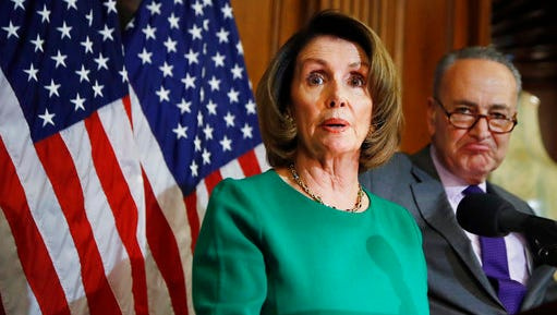 House Minority Leader Nancy Pelosi of Calif. with Senate Minority Leader Charles Schumer of N.Y. speaks to reporters about President Donald Trump's first 100 days, Friday, April 28, 2017, during a news conference on Capitol Hill in Washington. On Friday, the House easily passed a one-week spending bill to avert partial government shutdown at midnight, Senate votes next.