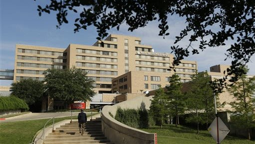 A man walks up the stairway leading to the Texas Health Presbyterian Hospital in Dallas, today.  A patient in the hospital is showing signs of the Ebola virus and is being kept in strict isolation with test results pending, hospital officials said Monday.