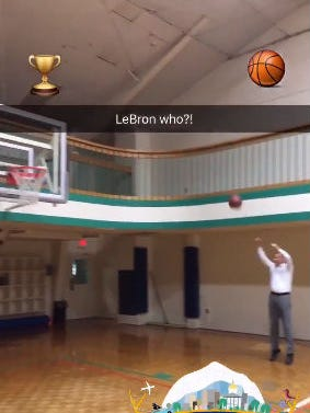 A screen capture from Gov. John Kasich's Twitter account of him sinking a jump shot.