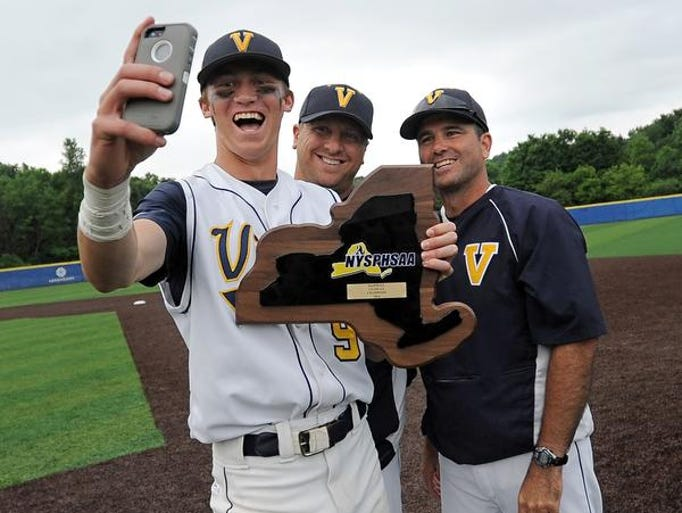 Victor's John Clemens, left, takes a selfie with the state plaque and his coaches Ben Lanning, center, and Sean Rucker.