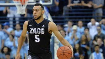 Gonzaga Bulldogs guard Nigel Williams-Goss (5) brings the ball up court during the first half against the San Diego Toreros at Jenny Craig Pavilion.