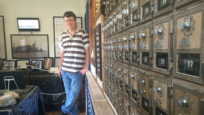 Doug Belote stands inside the Harborton History Museum, in the town's old post office.
