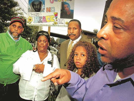 In 2012, Shirley Williams, in white blouse, mother of slain teenager Malik Williams, with supporters, from left: Kaseem Washington of Passaic; Terence Jones of Mullica Hill; Jasmine Rivera, Malik's girlfriend; and Victor Urbaez, attorney for the family.