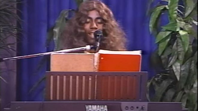 """With his long curly wig, white suit and tie, and goofy original ditties such as """"Spinning Wheel,"""" """"Meeting New People"""" and """"Freaky Freaky Girl"""" performed on a Yamaha keyboard with cheezy programmed drumbeats, Daryl Nathan became a true public access TV sensation in the 1990s."""