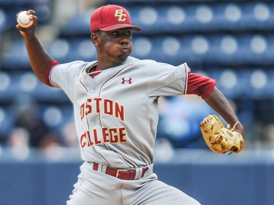 FILE - In this June 3, 2016, file photo, Boston College pitcher Justin Dunn throws against Tulane in the NCAA college regional baseball tournament game in Oxford, Miss. Dunn is a top prospect in the Major League Baseball draft.