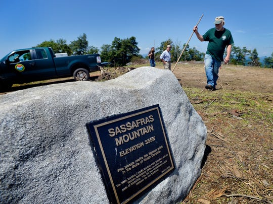 Dennis Chastain stands at the highest point on Sassafras Mountain, South Carolina's highest point, on Thursday, August 21, 2014.