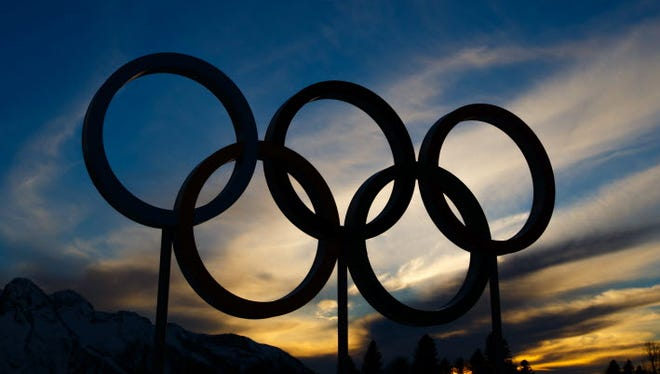 A view of the Olympic rings as the sun sets at the Laura Cross Country Ski and Biathlon Center during the Sochi 2014 Olympic Winter Games.