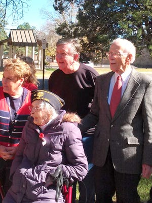 From left; Village of Ruidoso Manager Debi Lee, RSVP Veterans Ida Koehler, (seated) who served in the United States Marine Corps during World War II; Don Dulin, who served in the United States Army during the Korean War; and Robert Orr, who served in the United States Army during World War II, look on at the Veterans Day ceremony at the Ruidoso Community Center Wednesday.