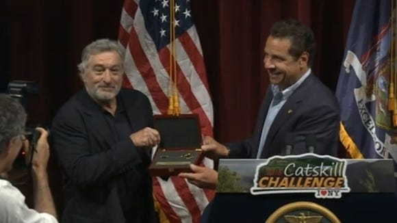 "Gov. Andrew Cuomo presents actor Robert De Niro with a ""key to the Catskills"" Thursday."