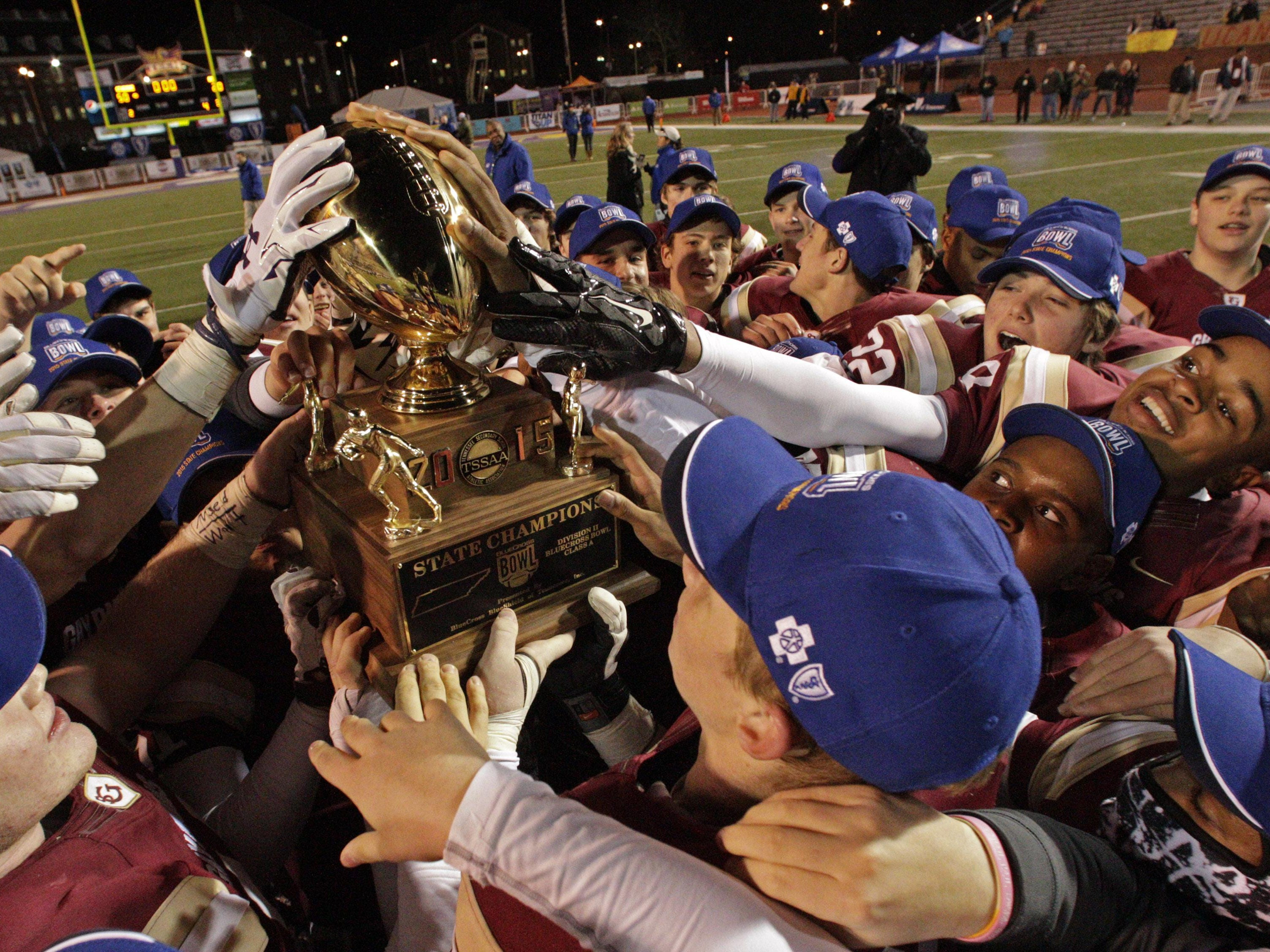 St. George's players celebrate their 50-20 victory Thursday.