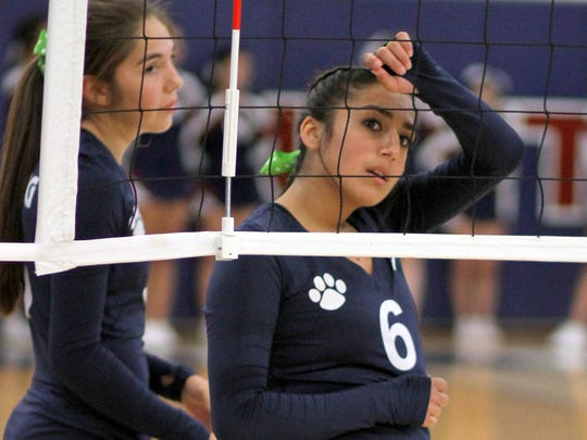 Lady Cat Micah Trevizo (6) takes a deep sigh at the net during Tuesday home match against the Hatch Valley Lady Bears.