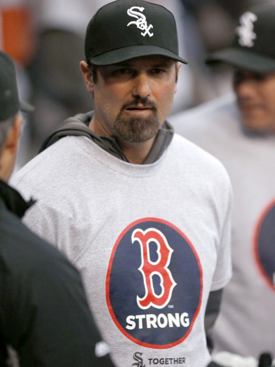 Chicago White Sox's Paul Konerko wears a Boston Strong shirt during ceremonies before the White Sox's baseball game against the Boston Red Sox in Chicago on Tuesday, April 15, 2014, one year after the Boston Marathon bombings. (AP Photo/Charles Rex Arbogast)