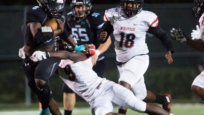 Demarcus Townsend, senior, runs as E'Quan Dorris tackles him during the game against South Fort Myers on Friday, October 28, 2016 at Gulf Coast High School in Golden Gate.