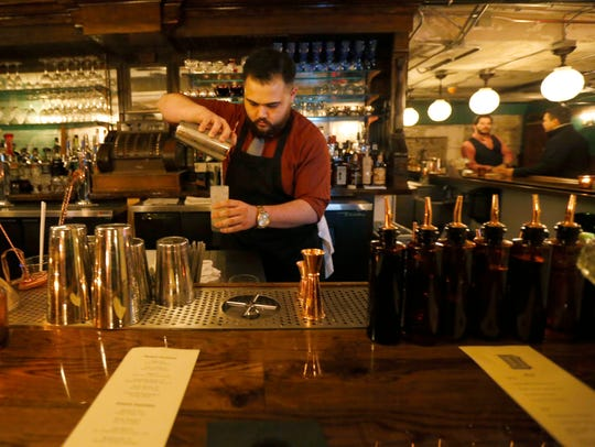 Bartender Jay Ryan pours a drink at The Hepburn, a