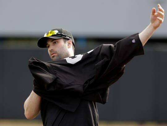 Major League Baseball free agent Neil Walker puts on