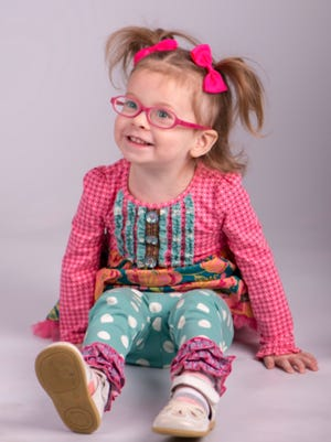 McKinley Sovey smiles happily. The 2-year-old is blind due to Leber's congenital amaurosis, a rare inherited retinal but a new treatment may let her see.