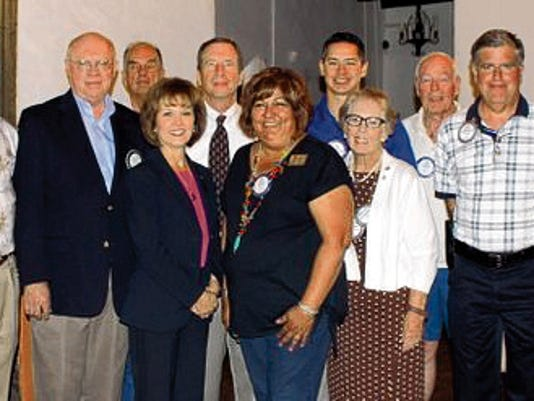 """Submitted Photo   The Deming Rotary officers are, in front and from left: Teresa Molina, board member; Ruth Stallard, treasurer; Mary Lou Cameron, outgoing president; Larry Donigan, president-elect; and Earl Greer Assistant District Governor. In back, from left, are:  board members Jim Dye, Ted Burr and  Bob Rodgers; Steve Westenhofer, incoming president;  Justin Alonzo, board member; and James """"Doc:  O'Connell, secretary."""