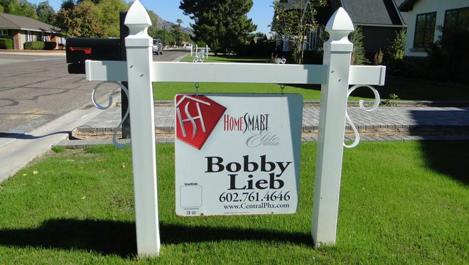 """Phoenix """"for sale"""" signs are disappearing. A sign in front of a north Central home."""