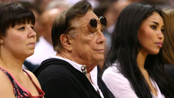 Donald Sterling watches the San Antonio Spurs play against the Memphis Grizzlies during the 2013 NBA playoffs in San Antonio, Texas.