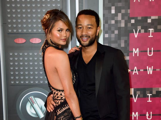 In this Aug. 30, 2015 file photo, Chrissy Teigen, left, and John Legend arrive at the MTV Video Music Awards in Los Angeles. The two were seen in the desert after the new year.