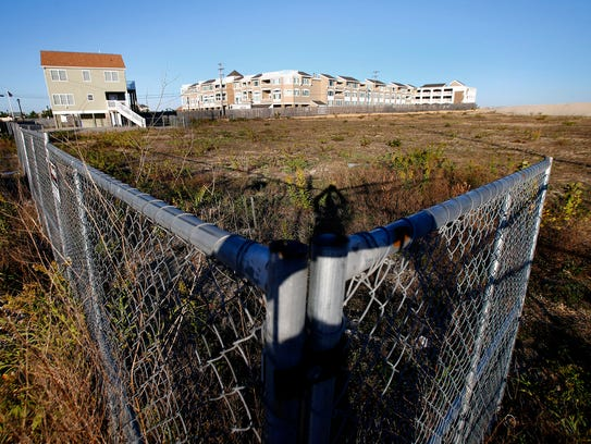 A fence surrounds an undeveloped area along Route 35