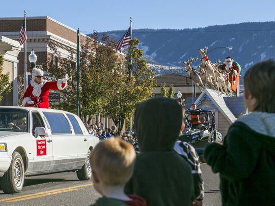 Mr. and Mrs. Claus ride down Main Street during Cedar City's Storybook Cavalcade Parade Saturday, Nov. 14, 2015.