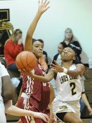 Abilene High's Sandrine Tuyizere (2) drives for a shot against Keller Central. The Lady Eagles beat Central 63-49 in the District 3-6A game Tuesday, Jan. 3, 2017 at Eagle Gym.
