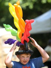 Paxson Stodghill dons a balloon mohawk at the 2014 Crescent Hill Fourth of July Festival.