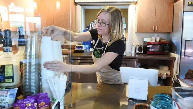 Lindsey works on an order at RedTail Coffee in the South Transit Center on Wednesday, May 11, 2016. The coffee shop with a mission to employ people experiencing or at risk of homelessness will have to close unless they can raise money to move to a location with more foot traffic.