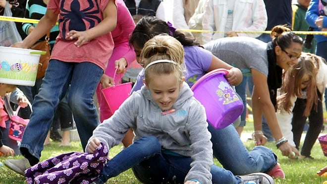 Children made mad dashes to fill their Easter Baskets during last year's Community Easter Egg Hunt.