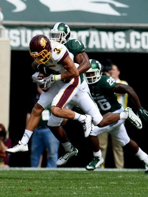 Central Michigan's Mark Chapman (3) with MSU's Demetrious Cox on his back during a game last season.