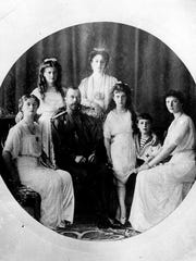 Russia's Czar Nicholas II, seated second from left, Czarina Alexandra, center rear, and their family are shown in this undated file photo. Bottom row left to right, Princess Olga, Czar Nicholas II, Princess Anastasia, Prince Alexei and Princess Tatiana. Top row left to right, Princess Maria and Czarina  Alexandra. (AP Photo/File)