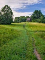 Rolling meadows with rustic cedar pavilions, footbridges