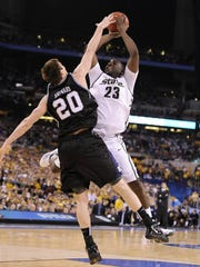 MSU' s Draymond Green has his shot blocked by Butler's Gordon Hayward late in the game as MSU tries to catch up.