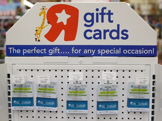 Gift of College gift cards are on diplay at Toys R