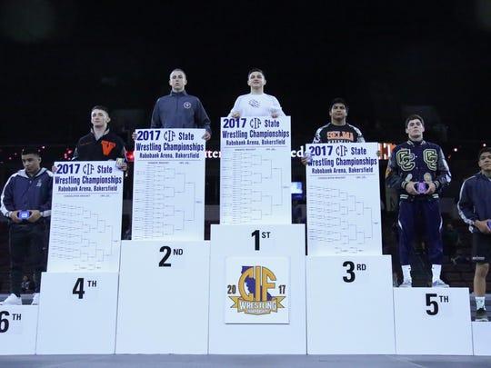 Mission Oak's Jaden Enriquez stands atop the podium