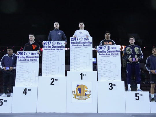 Mission Oak's Jaden Enriquez stands atop the podium in the 138-pound weight class on Saturday at the 45th annual CIF Boys Wrestling State Championships at Rabobank Arena in Bakersfield. Enriquez won state championship in his division.