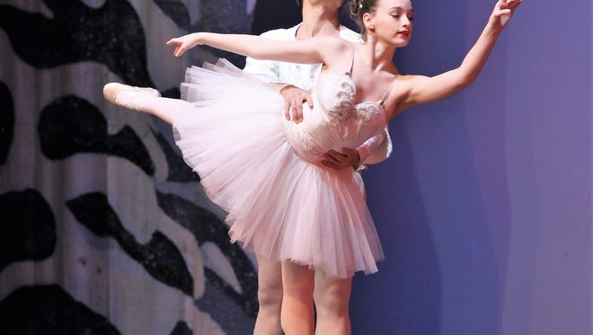 Meyer Blaine Maddox, playing the role of Snow Queen, and guest artist Stephan Fons, playing the role of Snow King, danced during the Dec. 9 presentation of 'The Nutcracker 2017' by the Ballet Arts Inc. at the Carl Perkins Civic Center in Jackson.