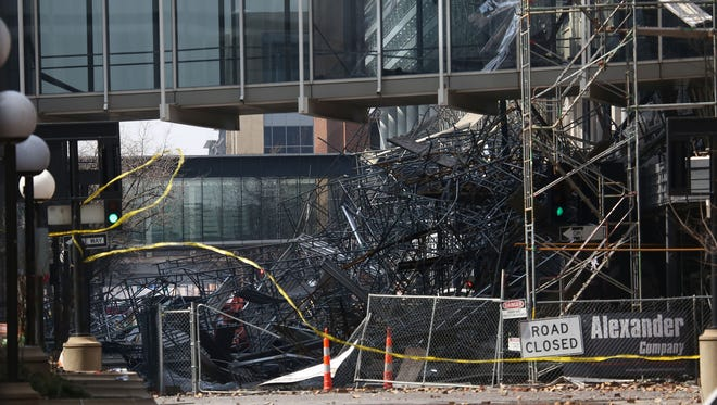 Cleanup crews and investigators begin working at the scene of the Younkers fire in downtown Des Moines Sunday, March 30, 2014.