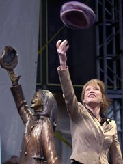 Mary Tyler Moore tosses her hat in front of the statue depicting the legendary opening of her television show in Minneapolis on May 8, 2002. The statue was created by Wisconsin sculptor, Gwen Gillen.