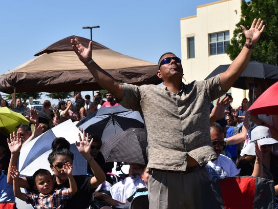 """A man rejoices during """"The Plunge"""" mass baptism event"""